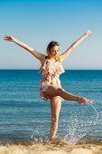 Summer Vacation. Girl Having Fun On The Sea Coast