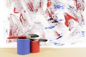 White Wall With Untidy Blue And Red Paint