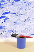 picture of untidiness  - Partly finished untidy or messy blue painted wall with paint can and paintbrush - JPG