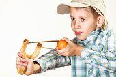 Kid Holding Slingshot In Hands