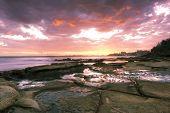 Rocks and waves at Kings Beach, QLD.
