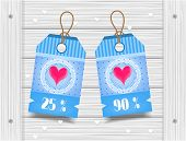 Two, blue stickers with pattern on wooden background