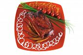 roasted beef on red dish with chives