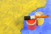Yellow And Blue Paint With Paint Tins