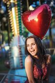 Smiling girl in the amusement park