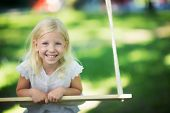 Little laughing girl outdoors