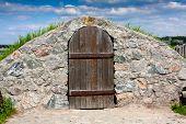 cold cellar with vintage wooden door