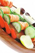 image of smoked salmon rolls on wooden plate