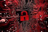 stock photo of cybercrime  - A graphic symbol of a security lock on red computer circuit board background - JPG