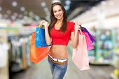 Beautiful lady with shopping bags, isolated on white background