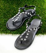 Sandals With Rhinestones On Green Grass. View From Above. Isolate On White.