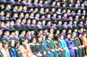 Shot Of Graduate At Graduation Ceremony. The Image Was Blurred For Use As A Background.