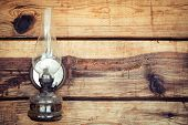 Paraffin Lamp On Wooden Wall