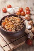 stock photo of stew pot  - Minced meat stewed with cherry tomatoes onion and garlic in a clay pot - JPG