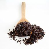 Thai Black Jasmine Rice (rice Berry) In Wooden Spoon On White Background