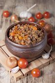 picture of stew pot  - Minced meat stewed with cherry tomatoes onion and garlic in a clay pot - JPG
