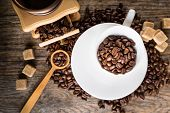 Coffee Beans With Grinder And Coffee Cup