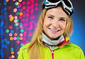 Studio shot of snowboard woman on christmas background