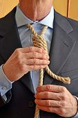 picture of hangman  - Hangman adjusting a noose rope like tie - JPG