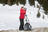 Female Photographer Takes Pictures In Winter Landscape
