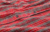 Man's red cotton plaid shirt detail