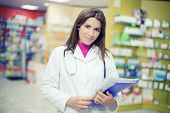 Beautiful Doctor In Pharmacy Looking