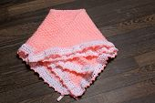 hand made baby blanket isolated on wood