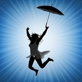 Young jumping woman with umbrella having fun and being active