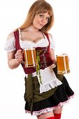 young blond woman with Oktoberfest beer in hand