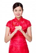 Chinese woman with two finger cross for blessing good luck