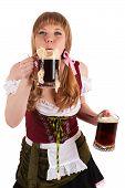 Oktoberfest woman blows with beer foam