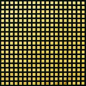 Pattern Of Black-yellow Grate On A Wall Surface.