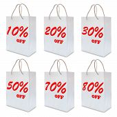Discount Sign Label On White Paper Bag