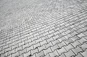 Texture Of Modern Gray Cobblestone Road Pavement
