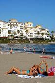 Sunbathers on beach, Marbella.
