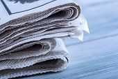 Newspapers folded and stacked on the table