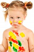 A little sad girl covered in paint. Art and painting concept. Creative childhood. Education. Isolated over white background.