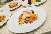 Warm Salad with Salmon Steak, potato, tomato and capers