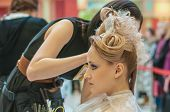 Hairdresser Makes The Wedding Hairstyle.
