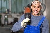 Construction Worker Posing With Angle Grinder