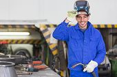 stock photo of torches  - Professional welder posing with wellding machine and torch  - JPG