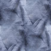 old wrinkled blue jeans seamless texture