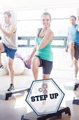 The word step up and instructor with fitness class performing step aerobics exercise against hexagon