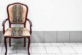 foto of gobelin  - lone old mahogany armchair in its empty room - JPG