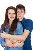 Beautiful young smiling couple hugging