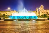 Belem, Lisbon, Portugal at the Jeronimos Monastery fountain at night.