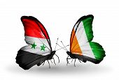 Two Butterflies With Flags On Wings As Symbol Of Relations Syria And Cote Divoire