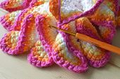 stock photo of doilies  - Crochet colored yarn knitted doily beautiful decoration for the home - JPG