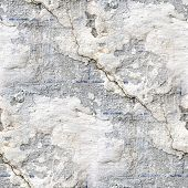 seamless texture of old stone wall with a crack