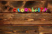 Word creativity on wooden background